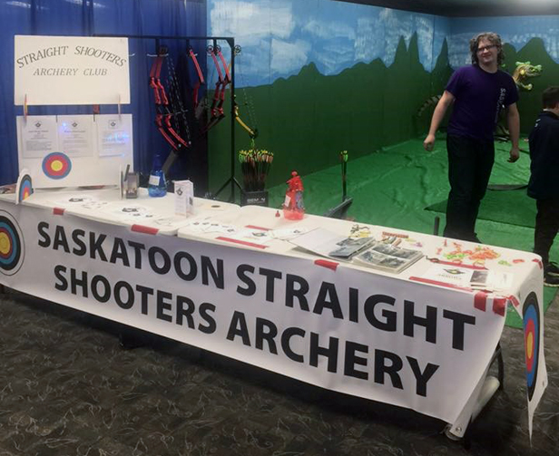 Visitors to the Sports & Leisure Show get a chance to try archery with the help of our members.